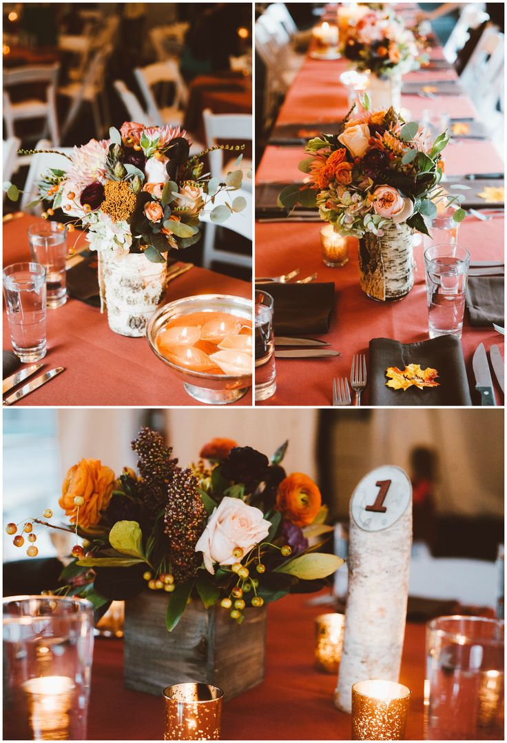 Indoor autumnal wedding reception table decor, wooden table numbers, fall leaves at each place setting, burnt orange tablecloths, black napkins, roses // Red Aspen Photography