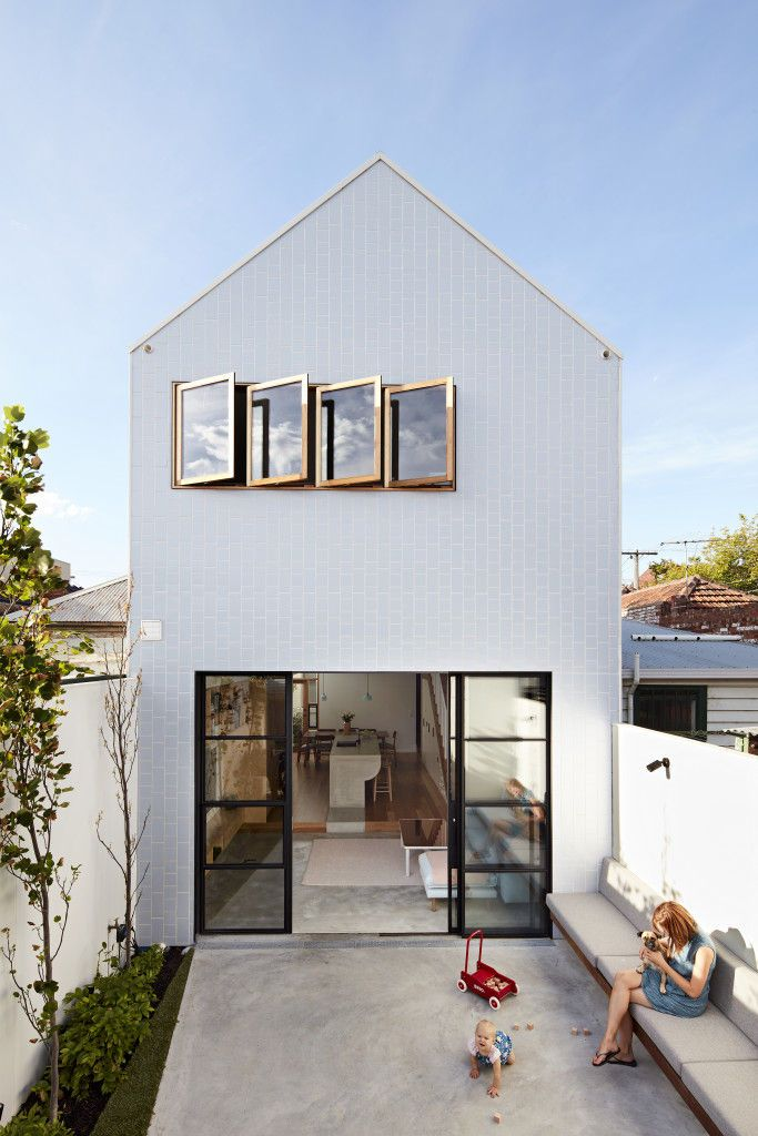 The Scyon Axon cladding of this gabled Melbourne addition gleams at midday.