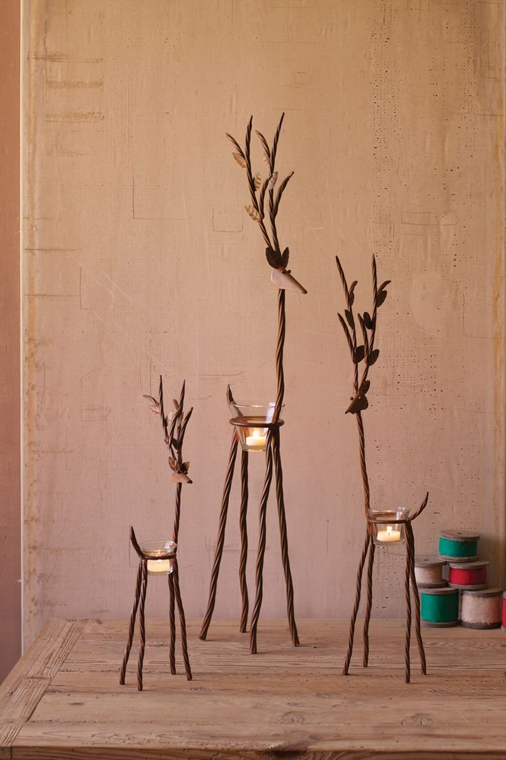 "Light up your home this holiday season with this charming set of three rustic iron reindeer! Each comes with a glass tealight holder. Candles not included. large: 4½"" x 7½"" x 36""t medium: 3"" x 6"" x 27""t small: 2½"" x 5"" x 19½""t"
