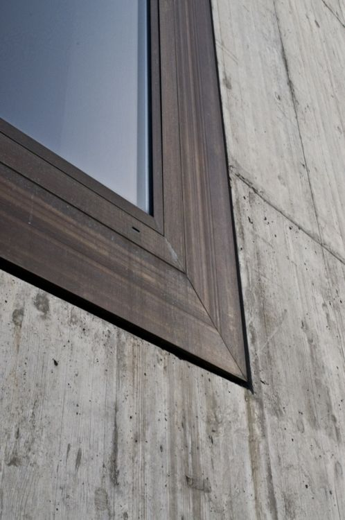 Window detail of Valerio Olgiati's School in Paspels. Concrete and bronze.