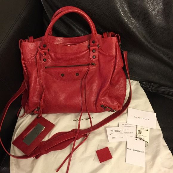 Balenciaga Velo in Coquelicot red Stunning Balenciaga Velo moto bag.  Excellent used condition with no particular areas of wear to note.  Comes with dustbag, cards, invoice from Reebonz.com and Reebonz box.  Price is firm.  I don't mind keeping this classic Handbags Balenciaga