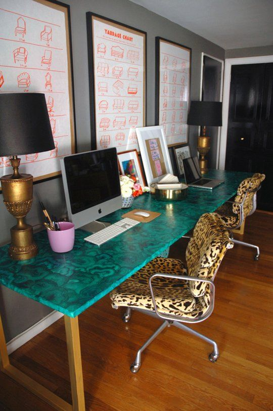DIY malachite desk, brass lamps with black shades, gold lamps, leopard seat cushions