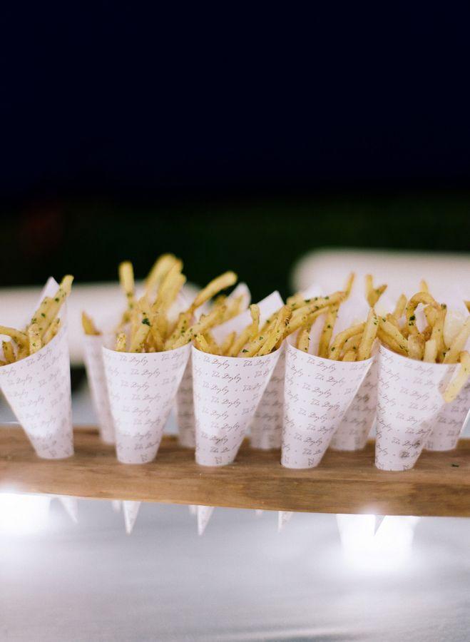 Seasoned french fry cones: http://www.stylemepretty.com/2016/02/26/elegant-seaside-wedding-with-a-pop-of-orange/   Photography: Joel Serrato - http://joelserrato.com/