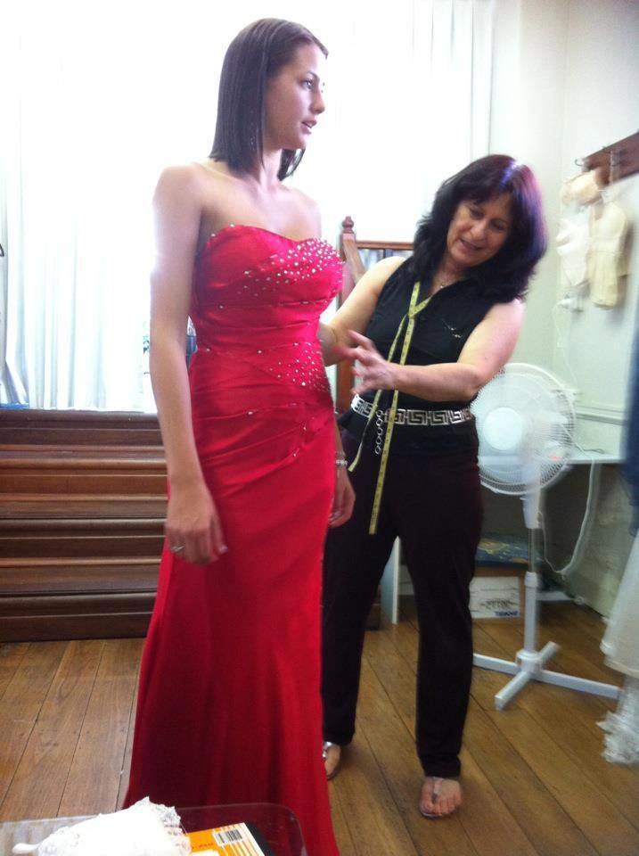 Red sheath evening gown with rhinestone detail http://www.arcarocouture.com.au/