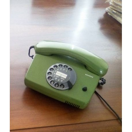 Vintage siemens telephone with rotary in green color very retro