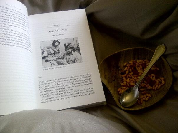 Sick, in bed. So reading the way-overdue Steve Jobs' bio along with mom's murmura for some TLC :)
