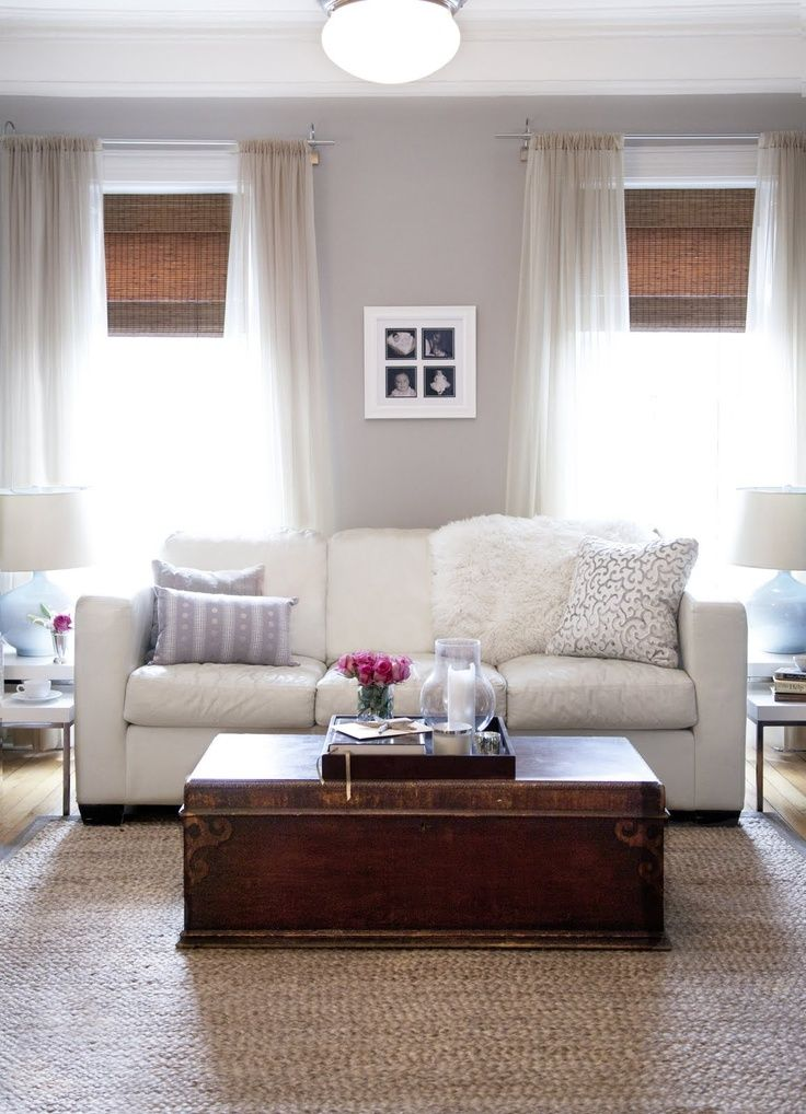 the elegant abode soft gray walls paint color white leather 3 cushion modern sofa lilac pillows vintage trunk table seagras