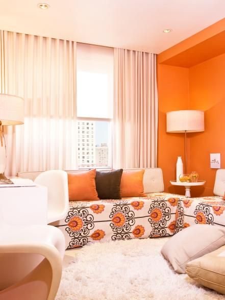 Just because your living room is small doesn't mean you have to sacrifice fun. Use bright colors and cool graphics to add interest to the space. Just be sure to limit your palette to two or three colors for a look that's exciting but not overwhelming. Design by Andrew Suvalsky