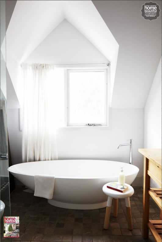 We love this light and airy bathroom nook with a chic egg-shaped bathtub