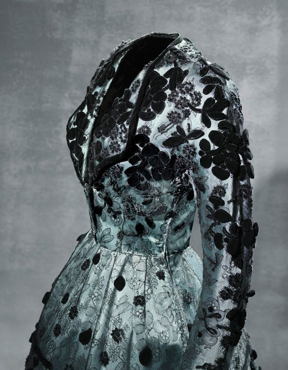 Dress in blue rayon satin and machine-made black silk lace, with smooth velvet appliqués and chenille embroidery  1947 Ca. Worn by Blanca Fernández de Rivera, Marchioness of Garcillán.
