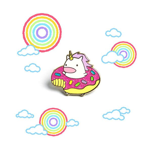 Now with glitter frosting! The donut unicorn is ready for some summer funin your company! This is a hard enamel pin and has a gold finish, so shiny! Take this pin with you to all your happy donut adventures! The pin measures about 1 inch tall and 1 inch wide and comes packaged