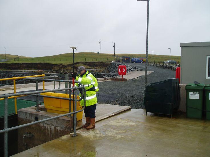 Guy checking some measurements at the Fair Isle Ferry Terminal #surveyor #surveying #scotland #fairisle