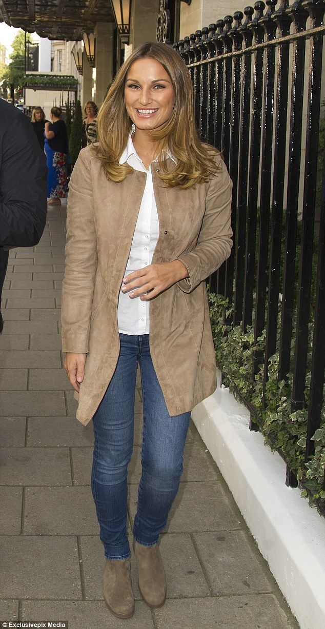 Dazzling: The 25-year-old former TOWIE star looked stunning and ladylike in a nude suede jacket with skin-tight jeans as she stepped out with her adorable family for a lunch at the luxurious hotel