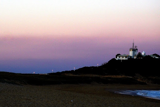 Lighthouse at Sunset by Carleen Corrie - Lighthouse at sunset Click on the image to enlarge.