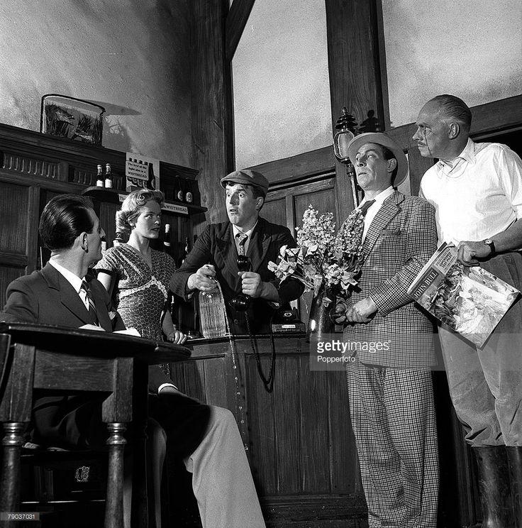 Cinema, England, 1955, A scene from the film 'Dry Rot', showing L-R: John Chapman, Diana Calderwood, Brian Rix, John Slater, and Charles Coleman