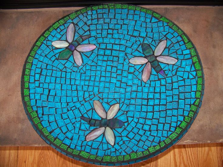 Made from a Satellite Dish to Bird Bath using stained glass.