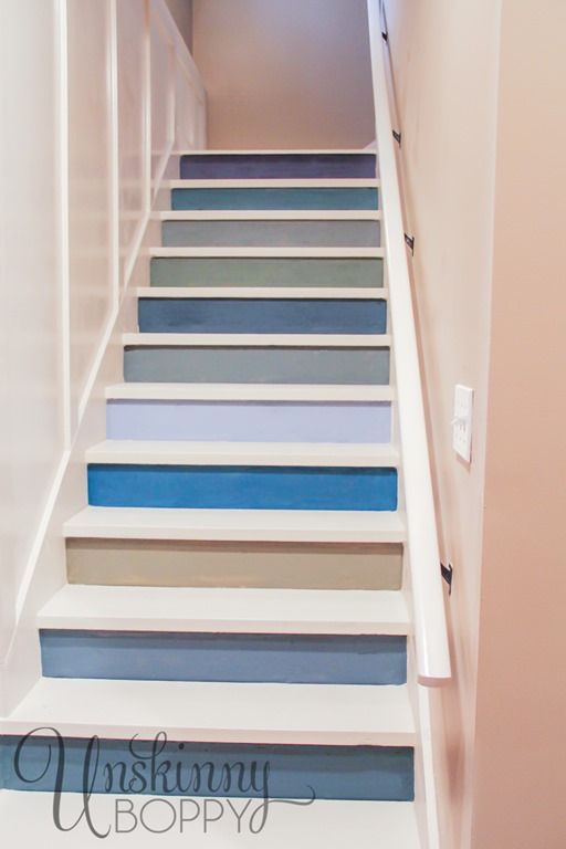 Different Shades Of Blue Create A Unique Basement Staircase.