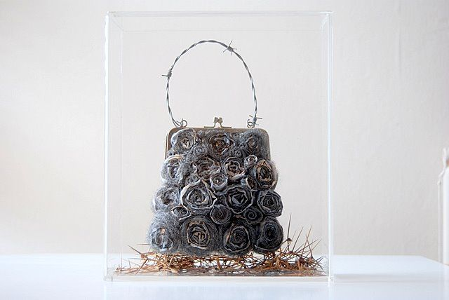 Sinner's Handbag made from stitched silk rouleaux and steel wool