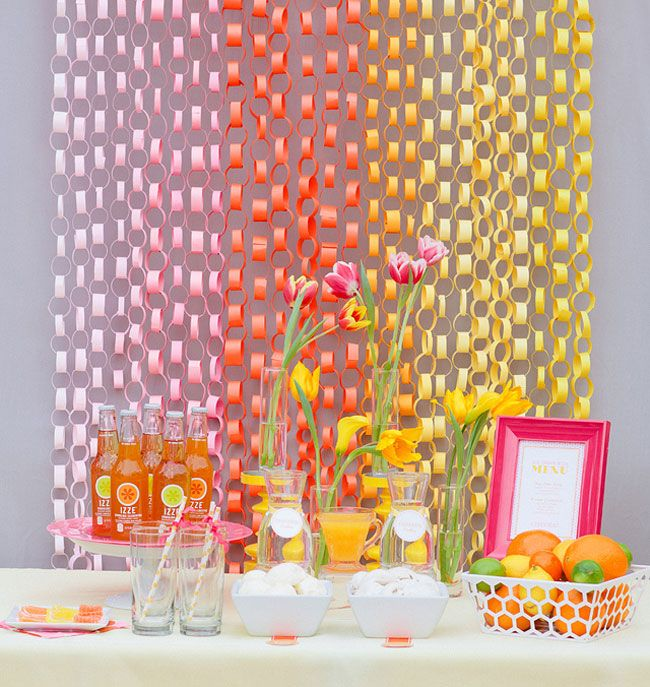 Make a bright backdrop out of different color paper chains. This is also great to use for a photo booth.