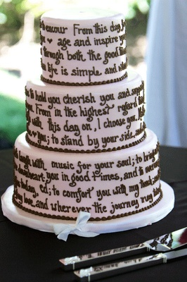 Marriage vows on the cake. LOVE, probably photographs well with the bride and groom, love that.. love this idea