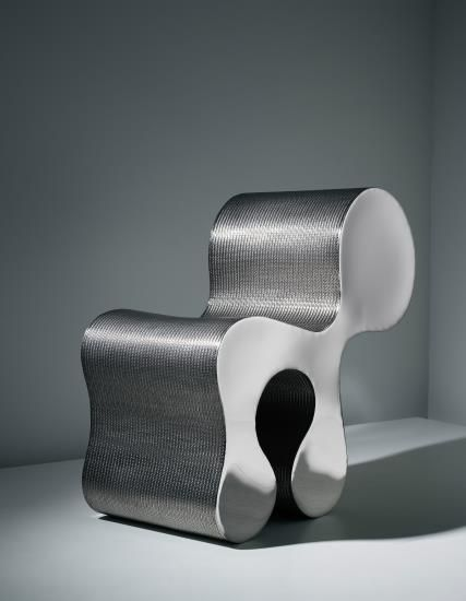 Ron Arad 'Creature Comfort' 1992. A chair of polished stainless steel and woven stainless steel. 75 x 40.6 x 32 cm (29 1/2 x 15 7/8 x 12 5/8 in.) Produced by One Off Ltd., London, UK. From the edition of 10 plus 3 artist's proofs.