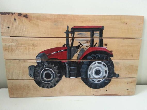 Case tractor red on reclaimed wood