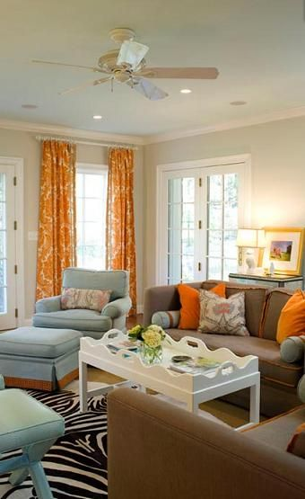 loving orange and blue decor: Orange Curtains, Colors Combos, Decor Ideas, Living Rooms, Living Room Colors, Livingroom, Brown Couch, Colors Schemes, Families Room