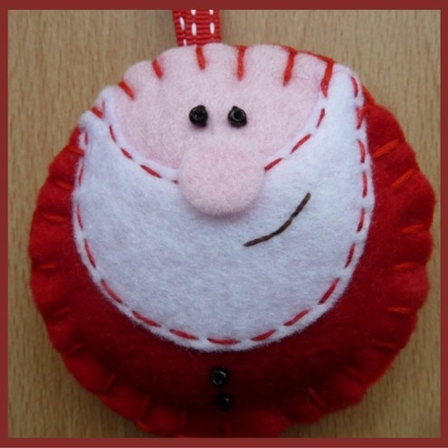 Cute Handmade Felt Santa Hanger~Designed by Julie Brownlow @Folksy: SOLD. A lovely hand stitched felt Santa~an ideal companion for the rockin' robin! An ideal hanger for your Christmas tree. Measures approx 70mm x 70mm (not including ribbon length)