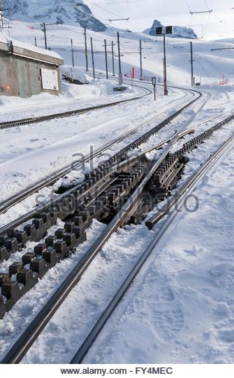 snow-covered-rails-of-the-gornergrat-railway-at-riffelberg-station-fy4mec.jpg (335×540)