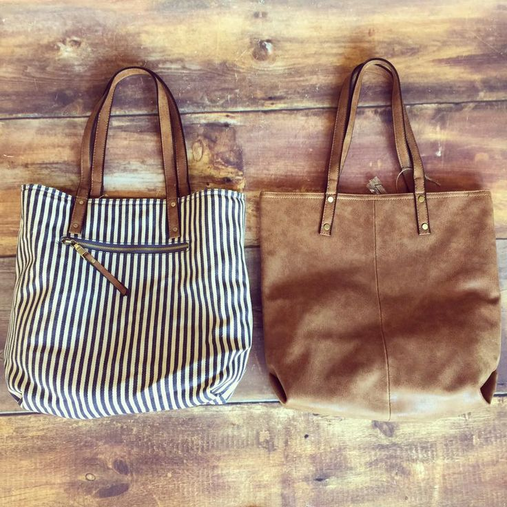 reversible tote purse with navy/white stripe on one side and distressed vegan leather on the other