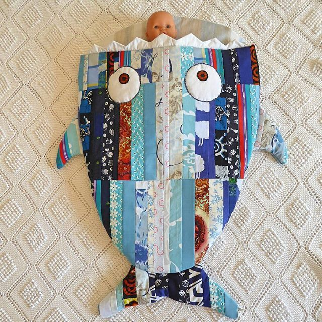 Oh life! A new baby came to this world, so I honor him with a new creation. To Vasco, a marine theme to sleep tight. (See it better at my website. Link on bio) . . . . . . #sharksleepingbag #andreiaanaif #madeinportugal #babysleepingbag #sleepingbag #shark #patchwork #chadebebe #babyblanket #blue #babyboygift #babyshower  Yeah, that baby doll is smaller than a real baby.