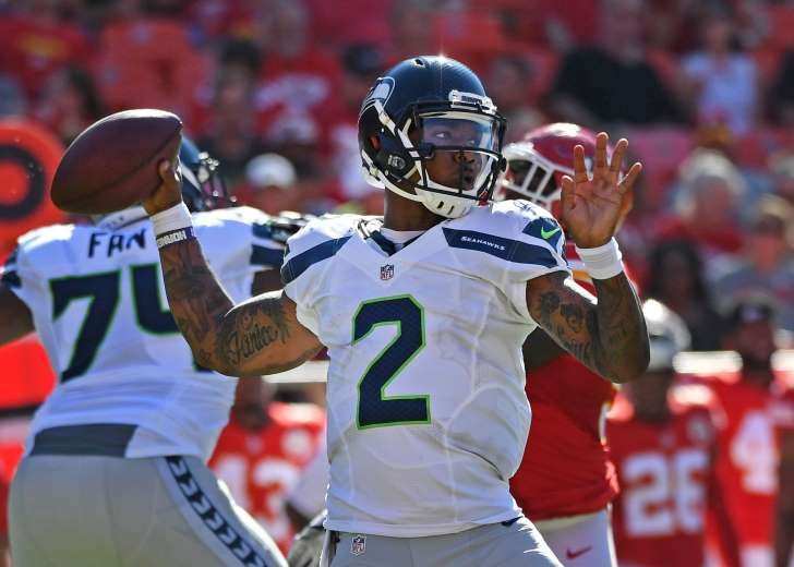 Seattle Seahawks backup quarterback Trevone Boykin was arrested early Monday morning in Dallas and charged with drug possession and public intoxication.  The Seahawks public relations department tweeted a statement later that...