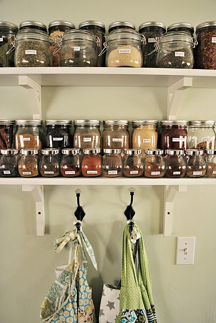 I organized my herbs and spices, using IKEA shelving and containers. I previously had them stuffed into a small cabinet, and every time I reached for a jar, everything fell out! So, now I have the ones I use most filled and in view. Perfecto!