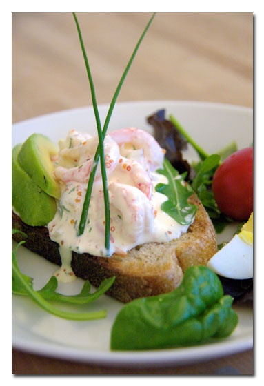 Toast Skagen is an elegant combination of prawns and other ingredients on a small piece of sautéed bread.