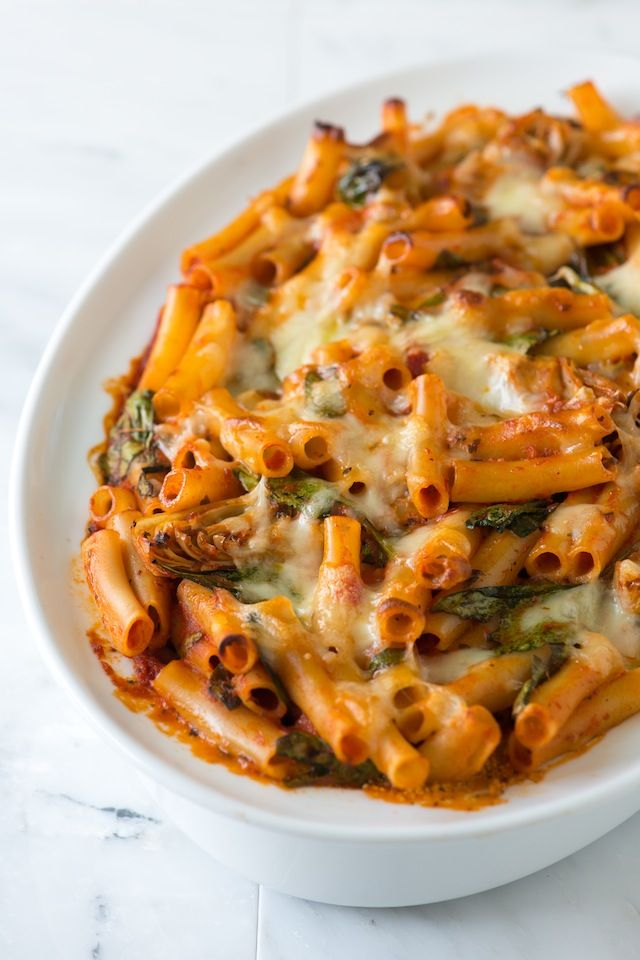 Easy Baked Ziti Recipe with Spinach, Artichokes and Pesto from www.inspiredtaste.net #recipe #pasta