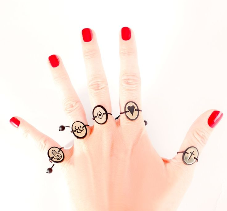 Fatima's hand, Om, Heart, Cross and Mashallah's eye...five simbols on our Lava and gold rings...