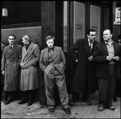 Philip Jones Griffiths 1958 GB. ENGLAND. There had been a hanging that morning in Pentonville prison in north London. A group gathered outside the still-unopened pub opposite the main gate. The executed man had lived nearby and these were some of his friends. 1958