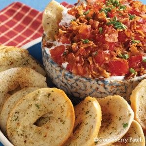 Creamy BLT Dip Recipe:  1 lb. bacon, crisply cooked and crumbled 1 c. mayonnaise 1 c. sour cream 2 tomatoes, chopped Optional: chopped fresh chives Instructions Blend together bacon, mayonnaise and sour cream; chill. Stir in tomatoes just before serving; sprinkle with chives, if desired. Makes 2-1/2 cups.