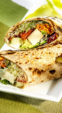 Holiday Wrap - avocado & tofu with a medley of vegetables served on a whole wheat tortilla with a side of marinated kale slaw.   Find it at: Fresh on Bloor http://www.freshrestaurants.ca/
