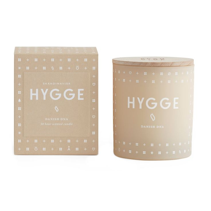 Hygge (pronounced Hu-Gah) is in the Danish DNA, a reflection of the Scandinavian art of creating intimacy, fellowship, and coziness in the smallest everyday moments. With echoes of tea and baked strawberry cake, rose petals, and wild mint. The painted glass container holds a blend of perfume and vegetable wax with a 100% cotton wick and engraved beechwood lid. Designed in Denmark, assembled in France.     Burn Time: 45+ Hours. Hygge Scented Candle by SKANDINAVISK