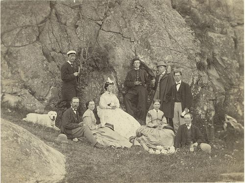 People and dog outdoors, Lysekil, Sweden  Men, women and a dog outdoors, probably in Lysekil. 1866