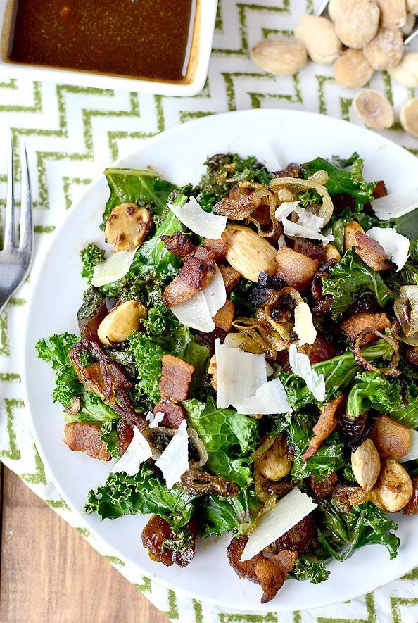 Gluten-free Warm Kale Salad with Bacon, Dates, Almonds, Crispy Shallots and Parmesan tastes like a bacon-wrapped, almond-stuffed date. Seriously decadent and delicious! | http://iowagirleats.com