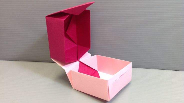 How to fold and combine two origami boxes to make a box with a hinge and a closure. ---------- Origami: Box Designed By: Traditional Origami Style: Pure (2 s...