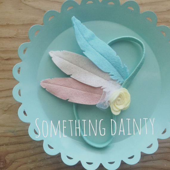 Sweetest little feather headband. Perfect for everyday, dress up, baby photoshoots and more. Sewn up in heirloom quality wool felt in blush, teal and