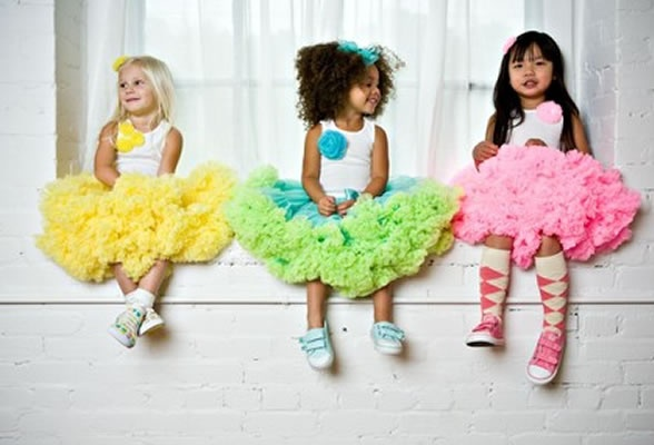 Flower girls in different colored tutus, leg warmers and converse. White tanks