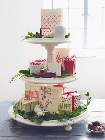 Display favorite Christmas cards on a tiered stand along with artificial greens, small presents and ornaments. More Christmas centerpieces: http://www.midwestliving.com/homes/seasonal-decorating/easy-christmas-centerpiece-ideas/?page=1
