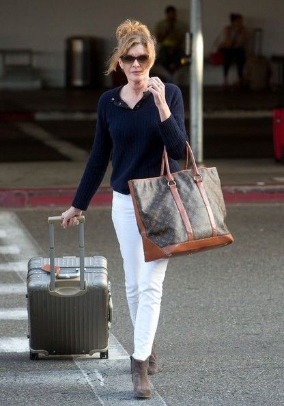 Rene Russo at the Airport - travel outfit