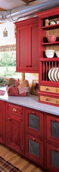 Prim Red Kitchen...love the punched tin drawer inserts and plate rack.