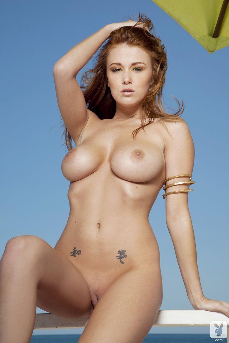 a boy felling a girls naked boobs