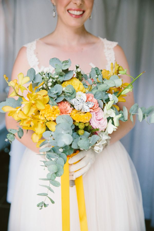 eucalyptus and yellow orchid bouquet with paper flowers, photo by Lad & Lass http://ruffledblog.com/villa-paradiso-wedding #weddingbouquet